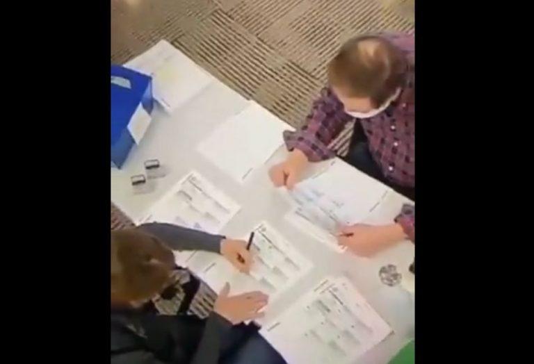 Mesários foram flagrados preenchendo votos ilegalmente para Joe Biden?