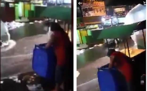 Mulher joga lixo na enxurrada durante enchente no Rio de Janeiro! Será verdade?