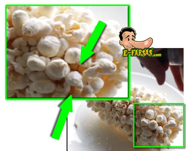 Aos 27 segundos do vídeo podemos ver os grãos de milho por baixo das pipocas, evidenciando que elas foram coladas por cima do milho!